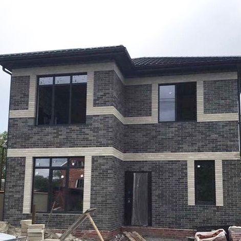 Фото дома из нового кирпича Литос